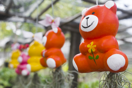 colorful ceramic teddy bears in the garden.