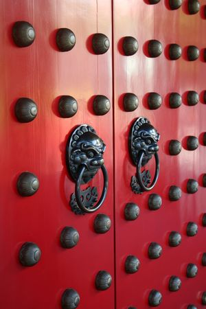 A common traditional asian doorway with the token door guardians. photo
