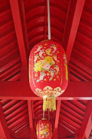 An auspicious red lantern hanging from the roof. photo