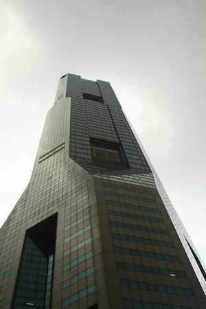foreshadowing: A grim looking corporate building foreshadowing trouble