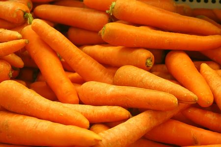 A tray of carrots in the market photo