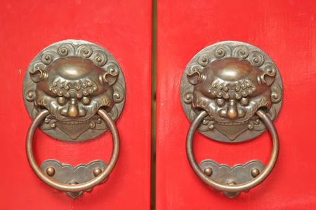 Chinese Door way with Handles and Gargoyles photo