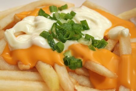 sinful: Melted cheese fries topped off with mayonaise and spring onions.