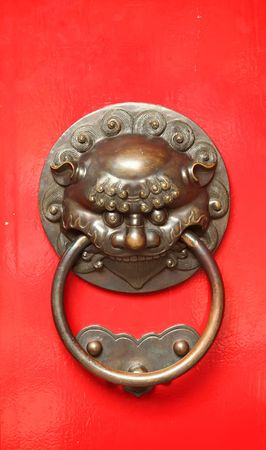 Aggressive door protector found on traditional chinese doors. photo
