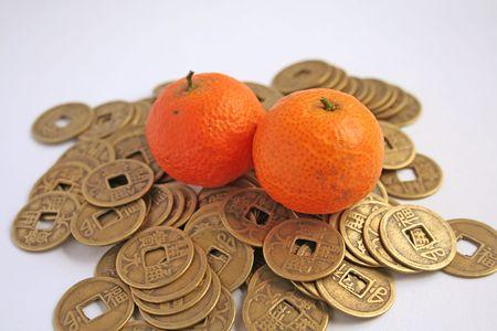 mandarins: Popular chinese symbols of wealth: mandarins and coins
