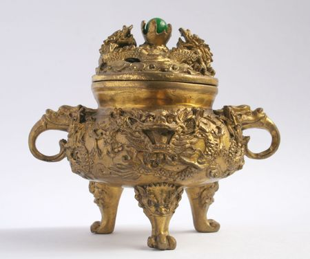 A traditional asian incense burner with a dragon head. photo