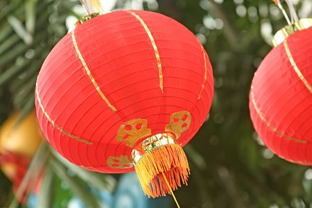 Asian red lanterns blowing in the wind in china town photo
