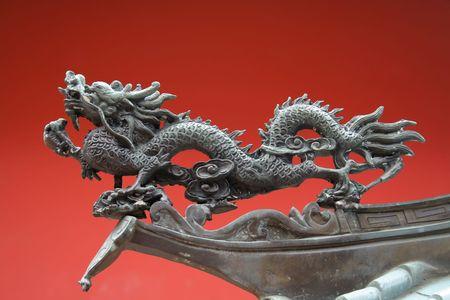 났습니다: An oriental dragon found in china town with red background 스톡 사진