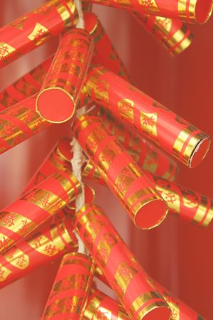 fire crackers: Red and gold chinese fire crackers popular during lunar new year celebrations Stock Photo