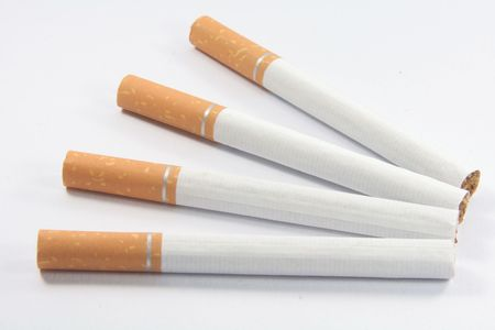 nicotine: Stop Smoking Cigarettes with nicotine, tar and tobacco isolated on white background