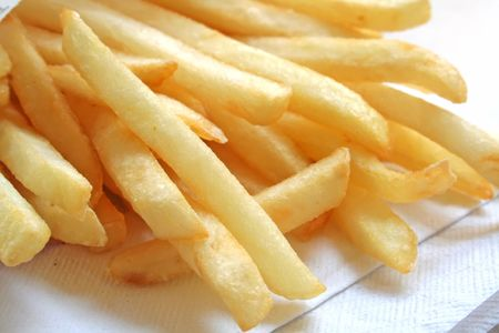 fries: French Fries the ultimate Fast Food Snack of the masses Stock Photo