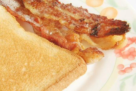Crispy Streaked Bacon with Toast Bread on white background photo