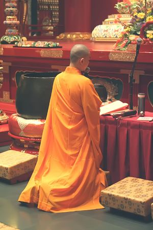 reciting: Monk Praying and Reciting Chants
