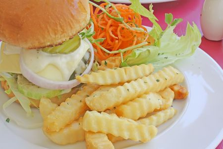 Hamburger Set Meal With French Fries and Salad photo