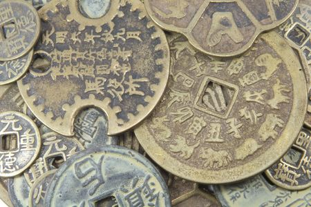 antique coins: Chinese Currency From Ancient China Isolated on a White Background