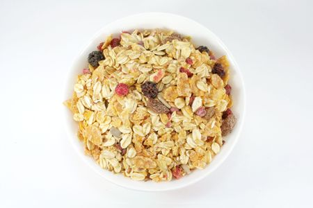 sultanas: Muesli Breakfast In A Bowl or Cup With White Background Stock Photo