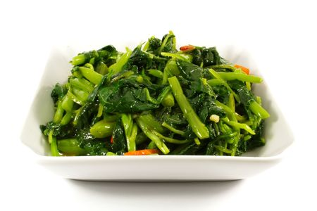 the greens: Healthy Greens Steamed Vegetables Isolated on a White Plate Stock Photo