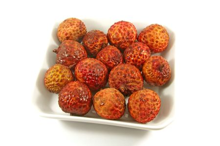 lychees: Plate of Lychees On a White Background