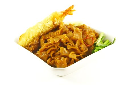 Stir Fried Asian Style Noodles On a White Plate photo