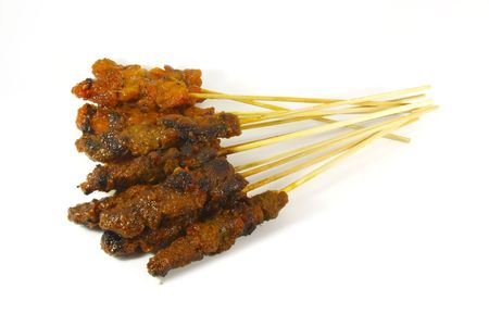barbecued: A popular and common food found in southeast asia consisting of barbecued meat on bamboo sticks