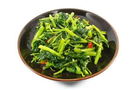 Single Serving of Chinese Vegetables on a Black Plate Stock Photo