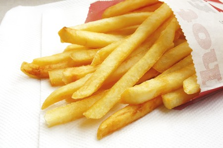 simple meal: French Fries the ultimate Fast Food Snack of the masses Stock Photo