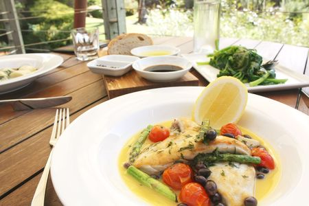 outdoor restaurant: Grilled Fish Meal in an Outdoor Restaurant Stock Photo