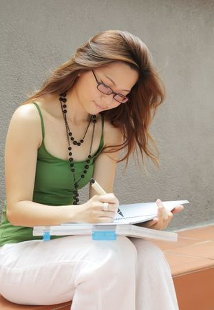 Asian Student Female Taking Notes in Campus photo