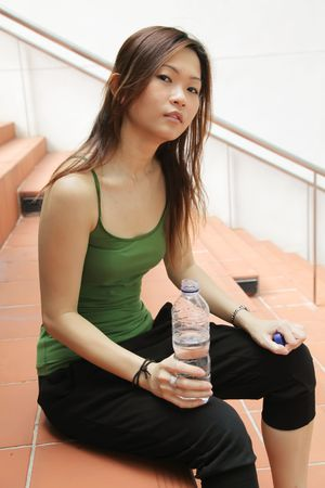recuperate: Tired Fitness Asian Babe as Health Concept Stock Photo