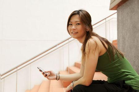 Asian Teenager Chilling Out With a Handphone Stock Photo - 5301597