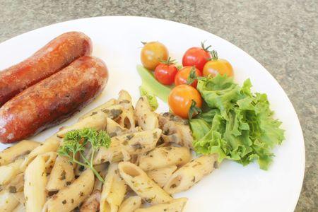 italian sausage: Creamy Pasta with Italian Sausage and Tomatos Stock Photo