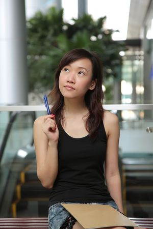 Asian Female Looking Up for Creative Inspiration Stock Photo - 5306707