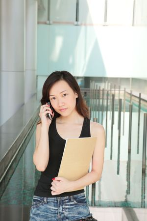 Asian Young Career Woman Outside an Office Stock Photo - 5310024