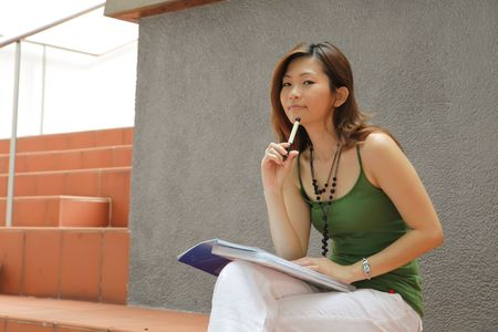 Asian Young Career Female Outside an Office photo