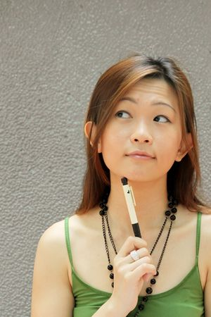 singaporean: Asian Student Thinking of College Course Choice Stock Photo