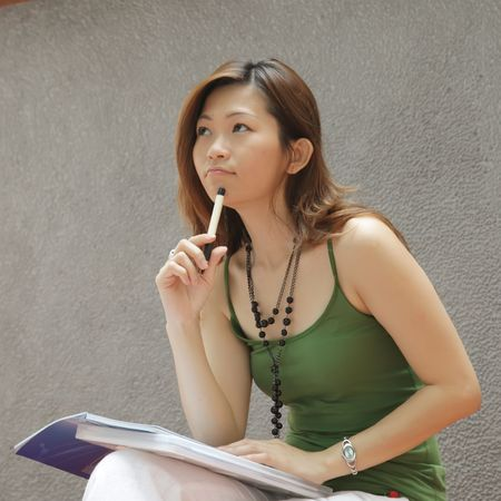 Asian Lady Thinking and Curious with Pen Stock Photo - 5314091