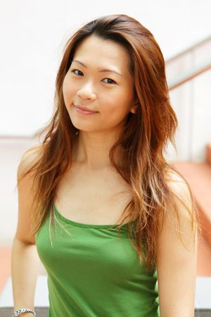 Friendly Gym Fitness Instructor Young Asian Lady photo