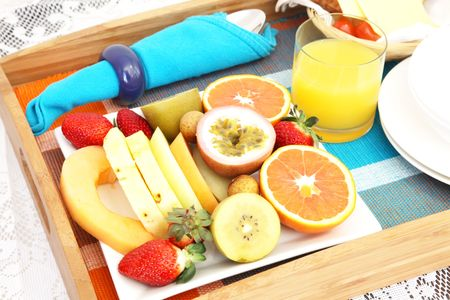 Breakfast in Bed with Assorted Fruits and Juice photo