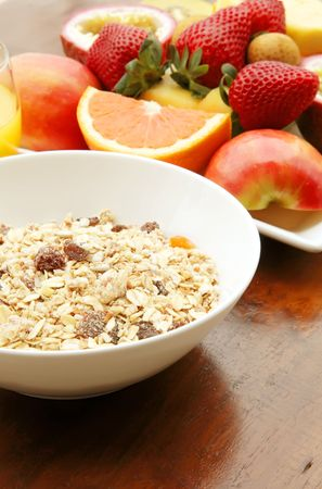 Muesli with Mixed Sliced Fruits Breakfast Meal photo