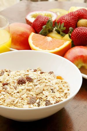 Muesli with Fresh Fruits on a Plate photo