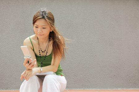 gprs: Teenager Texting Good News to her Friends Stock Photo
