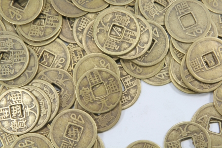 feng: Asian Old Business Currency Coins Pile Background Stock Photo