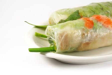 Fresh Handmade Vegetable Spring Rolls On White Surface photo