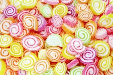 snoepjes: Kleurrijke snoep in een grote stapel als een Abstract Stockfoto