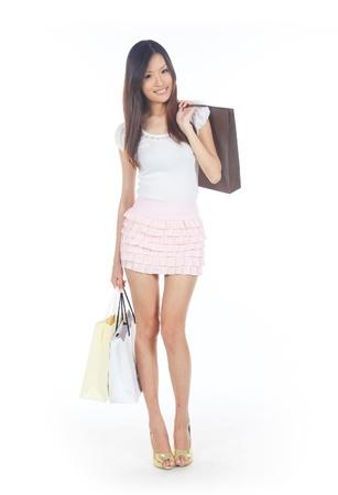 singaporean: Asian Shopper with Shopping Bags on White Stock Photo