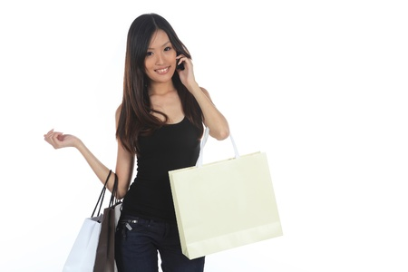 spree: Asian Woman Shopping With Bags Isolated on White Stock Photo