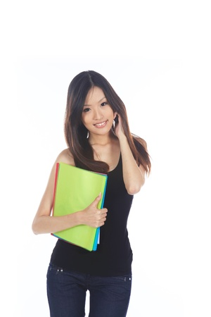 student: Asian Student in College With Folders on Phone Stock Photo
