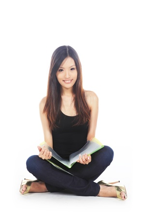 studious: Asian Student Studying for Exams and Test Stock Photo
