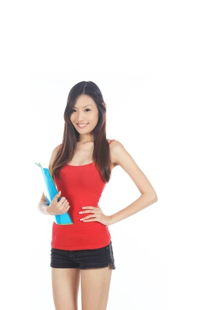 junior: Young Asian Chinese Student with Folders on White Stock Photo
