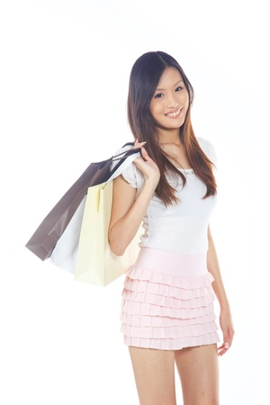singaporean: Happy and Smiling Asian Lady with Shopping Bags  Stock Photo